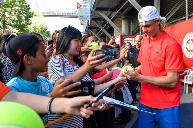 Shapovalov signs autographs for fans after defeating Rogerio Dutra Silva of Brazil on day five of the Rogers Cup on Aug. 8, 2017 in Montreal.