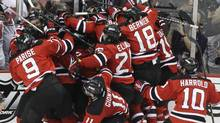 The New Jersey Devils celebrate after beating the New York Rangers 3-2 in overtime in Game 6 of the Stanley Cup Eastern Conference finals Friday, May 25, 2012, in Newark, N.J. The Devils advanced to the Stanley Cup finals. (Frank Franklin II/Frank Franklin II/AP)