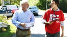 Liberal Keith Irving, left, and volunteer Conor MacNeil canvass in New Minas. (Paul Darrow for The Globe and Mail)