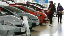 Visitors browse a Toyota showroom in Tokyo,Tuesday, Feb. 5, 2013. Toyota Motor Corp. reported its October-December profit rose 23 per cent. (Koji Sasahara/AP)