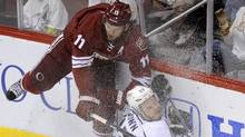 Ice sprays as Phoenix Coyotes' Martin Hanzal (L) crashes into the boards with Los Angeles Kings' Dustin Brown during the third period of Game 2 of the NHL Western Conference hockey finals in Glendale, Arizona, May 15, 2012. (Todd Korol/Reuters/Todd Korol/Reuters)