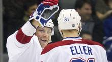 Montreal Canadiens Andrei Kostitsyn (L) congratulates Lars Eller after he scored against the Toronto Maple Leafs in the second period of their NHL hockey game in Toronto February 11, 2012. REUTERS/Fred Thornhill (Fred Thornhill/Reuters)