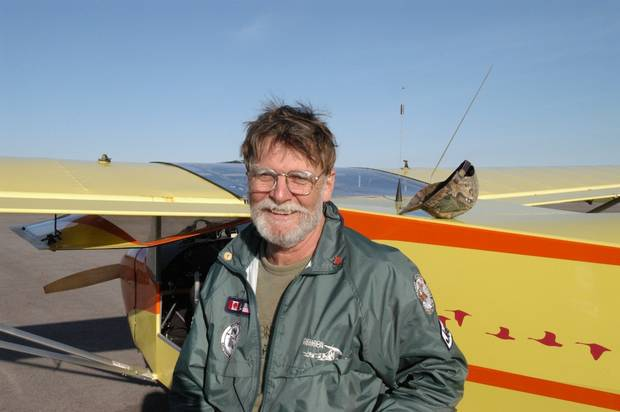Bill Lishman stands in front of a plane on Aug. 1, 2008.
