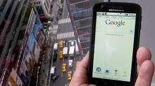 A posed picture shows a Motorola Droid phone displaying the Google search page in New York August 15, 2011. (BRENDAN MCDERMID/REUTERS)