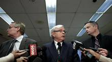 Grant Bowers, legal counsel for the TDSB (centre) addresses reporters at Toronto District School Board headquarters March 27, 2013 in connection with news of sexual assault charges against a teacher. (Moe Doiron/The Globe and Mail)