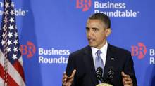 U.S. President Barack Obama gestures as he speaks about the 'fiscal cliff' at the Business Roundtable, an association of chief executive officers, in Washington, Wednesday, Dec. 5, 2012. (Charles Dharapak/AP)