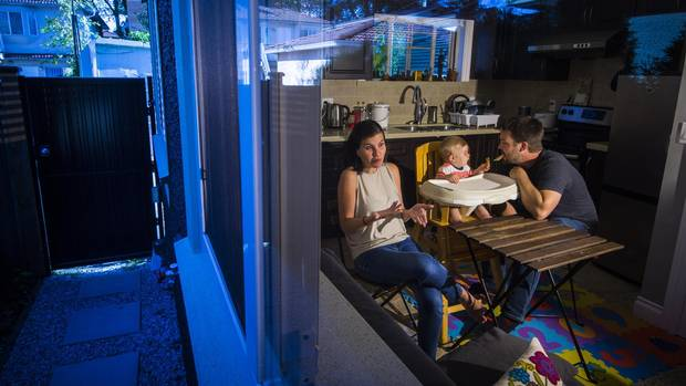 Brad Langman, Fiorella Pinillos and baby Marcelo, nine months in their Vancouver laneway home rental.