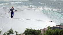 Jay Cochrane skywalks above Niagara Falls, Ont., between the Niagara Fallsview Casino Resort and the Hilton Hotel on, June 14, 2005, a distance of 650 feet and 400 feet above the ground. (MARK D. PHILLIPS/THE CANADIAN PRESS)