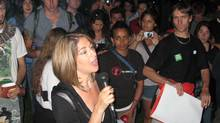 "Celebrity author Naomi Klein tells a crowd at Allan Gardens that the police ""didn't expect a bunch of middle-class people who paid $20"" for a ticket to the event to start a march in the middle of the night. (Amit Shilton/The Globe and Mail)"