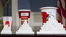 Soft drink cups are displayed at a news conference at City Hall in New York on May 31. Under a new law proposed by New York City Mayor Michael Bloomberg, all soft drinks over 16 ounces will be banned in restaurants and stores that fall under the jurisdiction of New York City. (ANDREW BURTON/REUTERS/ANDREW BURTON/REUTERS)