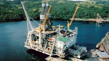 An aerial view shows the upper half of the Hibernia offshore oil platform sitting in the harbor at Bull Arm, northwest of St. John's, Newfoundland, in a file photo from August, 1996. Quebec and Newfoundland are facing another energy dispute over an oil field in the Gulf of St. Lawrence. (Reuters)