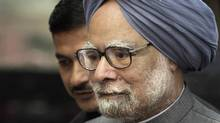 Indian Prime Minister Manmohan Singh arrives on the first day of the winter session of parliament in New Delhi on Nov. 22, 2011. (Manish Swarup/AP)