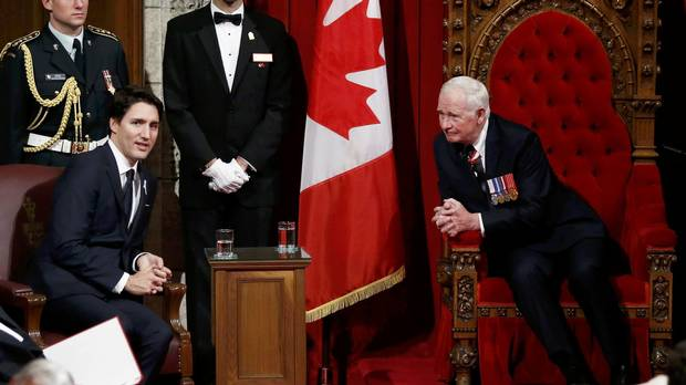 Governor-General David Johnston, right, chats with Prime Minister Justin Trudeau ahead of the delivery of the Speech from the Throne in the Senate chamber on Dec. 4, 2015.