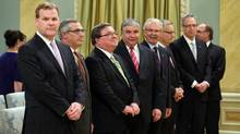 John Baird, Tony Clement, Jim Flaherty, Peter Van Loan, Gerry Ritz, Ed Fast, Joe Oliver and Bernard Valcourt arrives for the new cabinet's swearing-in on July 15, 2013. (DAVE CHAN FOR THE GLOBE AND MAIL)