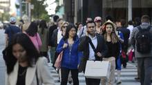 Shoppers in downtown Toronto. Slow income growth and rising living costs underscore the prediction by many economists that consumer spending will no longer drive economic growth in Canada. (Fred Lum/The Globe and Mail)