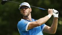 Graham Delaet of Weyburn, Sask., tees off during the final round of the Deutsche Bank Championship (Michael Dwyer/AP)