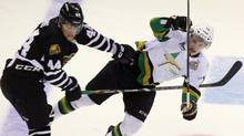 London Knights' Dakota Mermis hits Val d'Or Forerus Nocolas Aube-Kubel during first period Memorial Cup action in London on May 16. (Dave Chidley/THE CANADIAN PRESS)