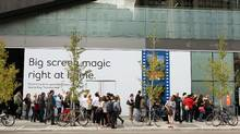 Movie-goers line up outside the TIFF Bell Lightbox in Toronto during the film festival last September. (Getty Images)
