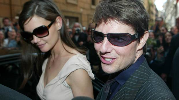 In an early sighting, Tom Cruise and new girlfriend Katie Holmes leave a restaurant in Rome after a lunch date in April 2005. (INFGoff.com)