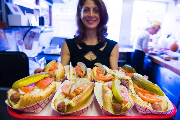 A stop on a Chicago Food Planet tour might include a Chicago-style hotdog.