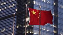 The Chinese national flag is seen in the financial district of Pudong in Shanghai September 22, 2011. (CARLOS BARRIA/REUTERS)