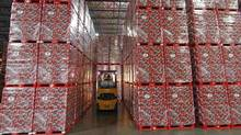 Coke's new productivity program is targeting annual savings of $350-million (U.S.) to $400-million by the end of 2015. (Georges Frey/Reuters/Georges Frey/Reuters)