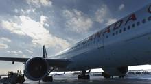 An Air Canada jet sits at the gate on Jan. 8, 2014. (Fred Lum/The Globe and Mail) (Fred Lum/The Globe and Mail)