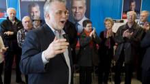 Quebec Liberal Leader Philippe Couillard waves to supporters in his home riding in Roberval after a campaign blitz accross the province, Sunday, April 6, 2014. Quebeckers are going to the polls on April 7. (Jacques Boissinot/THE CANADIAN PRESS)