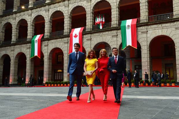 Mr. Trudeau, Ms. Grégoire Trudeau, President Enrique Pena Nieto and his wife, Angelica Rivera, leave the official welcoming ceremony at the National Palace.