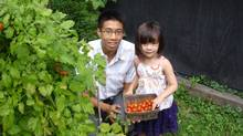 Young Urban Farmers co-founder Chris Wong with customer Sasha Cumming.
