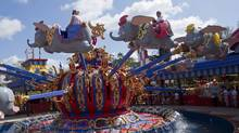 Guests take a spin on the Dumbo the Flying Elephant ride on March 12, 2012. The first part of the attraction features Dumbo spinning clockwise for the first time in Magic Kingdom history. (David Roark)