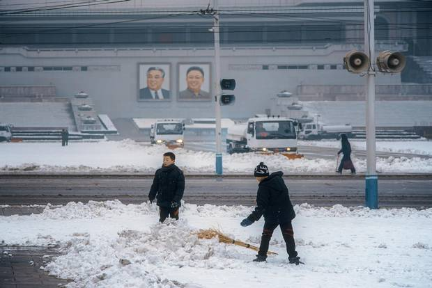 Boys take a break from their snow-removal tasks to stage a snowball fight in Kim Il-sung Square. Ringed with loudspeakers playing a constant loop of nationalist anthems and announcements, the plaza is anchored by the country's largest library: the 600-room Grand People's Study House.