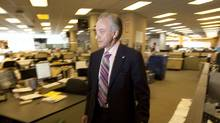 File photo of Postmedia Network Inc. CEO Paul Godfrey walking through the National Post newsroom in Toronto. (Darren Calabrese/Darren Calabrese For The Globe and Mail)