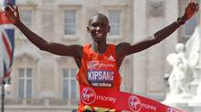 Kenya's Wilson Kipsang celebrates his win as he crosses the finish line during the London Marathon, London, Sunday, April 22, 2012. Kenya's marathon superiority was flaunted Sunday ahead of the Olympics, with Wilson Kipsang and Mary Keitany coasting to victory in London to virtually assure themselves of selection for the games. (AP Photo/Sang Tan) (Sang Tan/AP)