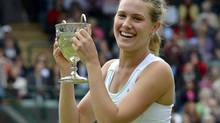 Eugenie Bouchard of Canada holds her trophy after defeating Elina Svitolina of Ukraine in their girls' final tennis match at the Wimbledon tennis chamionships in London July 7, 2012. (TOBY MELVILLE/REUTERS)