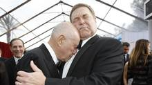 "Actors John Goodman and Alan Arkin from ""Argo"" embrace at the 19th annual Screen Actors Guild Awards in Los Angeles, California in this January 27, 2013 file photograph. A new show called ""Alpha House,"" whose pilot filmed in New York late February 2013, has many of the ingredients necessary for television success. Goodman, coming off notable roles in Oscar-winning movies ""Argo"" and ""The Artist,"" is the star. (MARIO ANZUONI/REUTERS)"