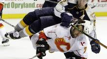 Calgary Flames right wing Todd Bertuzzi (7) collides with Nashville Predators defenseman Dan Hamhuis (2) in the second period of an NHL hockey game in Nashville, Tenn., Thursday, Oct. 23, 2008. (Mark Humphrey/AP)