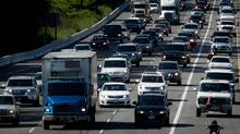 Traffic slows on Highway 1 eastbound near Kensington Ave. during the afternoon rush hour in Burnaby, B.C., on Monday June 2, 2014. (DARRYL DYCK for THE GLOBE AND MAIL)