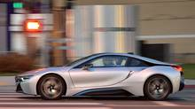 The 2015 BMW i8's hybrid-specific all-wheel drive means a combustion engine powers the rear wheels, while an electric motor drives the front wheels. (BMW)