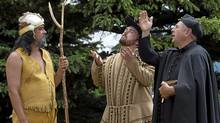 Actors portray Mi'kmaq Grand Chief Henri Membertou, settlement leader Poutrincourt and Father Jesse Fleche, left to right, in the re-enactment of the baptism 400 years ago of Membertou in Annapolis Royal, N.S. (Andrew Vaughan/CP)
