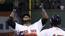 Boston Red Sox's David Ortiz celebrates with Dustin Pedroia after hitting a grand slam home run in the eighth inning during Game 2 of the American League championship series against the Detroit Tigers Sunday, Oct. 13, 2013, in Boston. (Matt Slocum/AP)