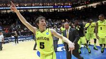 Baylor University's Brady Heslip celebrates after beating Colorado University 80-63 in their men's NCAA basketball game in Albuquerque, New Mexico, March 17, 2012. (Eric Draper/Reuters/Eric Draper/Reuters)