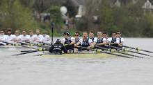 The Cambridge University rowing team, left, pulls away from Oxford University after Oxford lost a paddle during boat race on the River Thames in west London April 7, 2012. (PAUL HACKETT/Reuters)