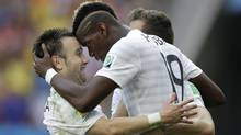 France's Paul Pogba celebrates with teammate Mathieu Valbuena, left, after scoring during the World Cup round of 16 soccer match between France and Nigeria at the Estadio Nacional in Brasilia, Brazil, Monday, June 30, 2014. (Ricardo Mazalan/AP)