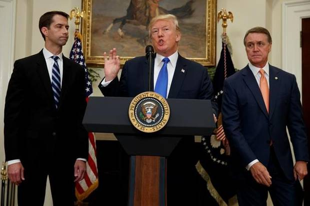 President Donald Trump, flanked by Sen. Tom Cotton and Sen. David Perdue speaks during the unveiling of legislation that would place new limits on legal immigration on Aug. 2.