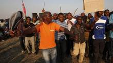 Striking platinum mine workers gather for a report back on negotiations at Lonmin's Marikana mine in South Africa's North West Province, August 29, 2012. (MIKE HUTCHINGS/REUTERS)