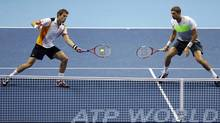 Daniel Nestor of Canada, left, and Max Mirnyi of Belarus, right, play a return during their doubles tennis match against Robert Lindstedt of Sweden and Horia Tecau of Romania at the ATP World Tour Finals in London Monday, Nov. 5, 2012 (Associated Press)