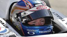IndyCar driver Paul Tracy, center, of Canada, sits in his car during practice for the Grand Prix of Long Beach IndyCar auto race in Long Beach, Calif., Friday, April 15, 2011. (AP Photo/Jae C. Hong) (Jae C. Hong/AP)