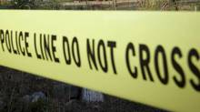 Police tape demarking a crime scene. (JOHN LEHMANN/The GLOBE AND MAI)