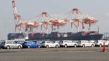 Newly produced cars await shipment at an industrial port in Yokohama. (© Toru Hanai / Reuters/REUTERS)